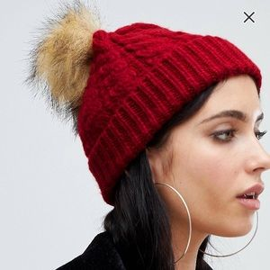 Knitted bobble hat in red